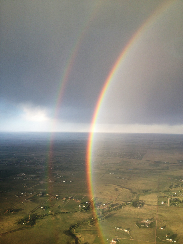 image of a double rainbow taken from a plane