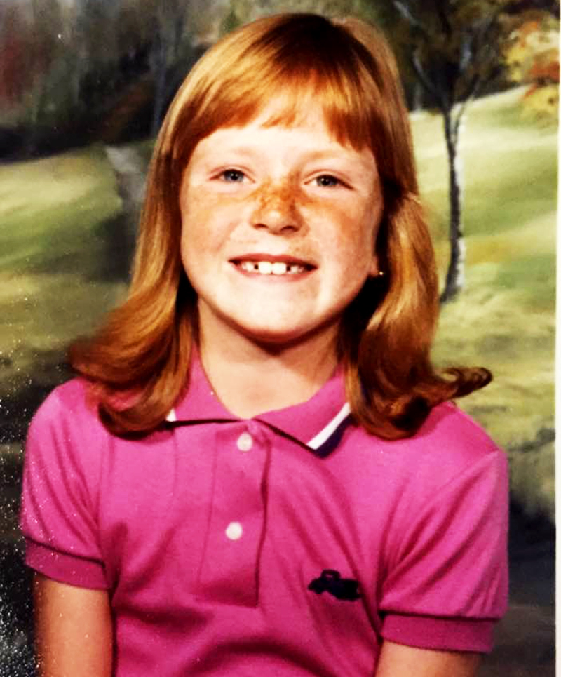 grade school pic of a redheaded freckled face girl