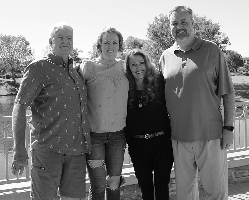 portrait of a four person family in black and white